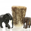 Carved elephants with African drum — Stock Photo