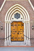 Wooden entrance door of church — Stock Photo