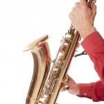 Постер, плакат: Man playing saxophone in closeup
