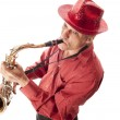 Man with hat playing saxophone — Stock Photo