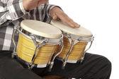 Man playing bongo on his lap — Stock Photo
