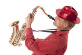 Man playing saxophone with devotion — Foto Stock