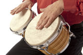 Man playing bongo set on his lap — Stock Photo