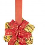 Coockie hanging on Christmas ribbon — Stock Photo #38429265