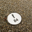 Numbered direction sign in pavement — Stock Photo #39550857