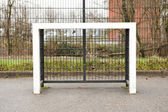 Square schoolyard soccer goalpost front view — Stock Photo
