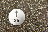 Numbered direction plate in pavement — Stock Photo