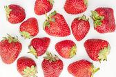 Strawberries in bed of yoghurt — Stock Photo