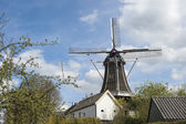 Wooden wind mill in urban setting — Stock Photo