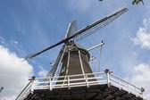Wooden wind mill taken upwards — Stock Photo