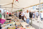 Market booth filled with books — Stock Photo