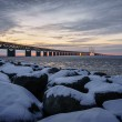 Snow covered boulder by the Øresund Bridge — Stock Photo