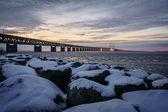 Snow covered boulder by the Øresund Bridge — Stock Photo