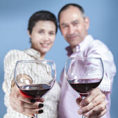Couple toasting with a red wine — Stock Photo