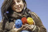 Young knitter with coloured yarn of wool — Stock Photo