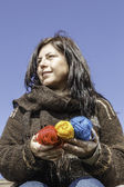 Young knitter with coloured yarns of wool — Stock Photo
