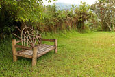 Unique Wooden Bench in a meadow — Stock Photo