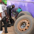 Stock Photo: Changing Bus Tire and Brakes in Africa