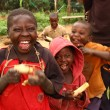 Happy Ugandan Children Eating Sugarcane — Stock Photo