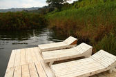 Rustic Wooden Lake Lounge Chairs — Stock Photo