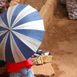 Umbrella Covered African Market Vendor — Stock Photo