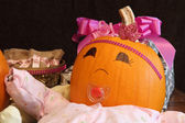 Happy Pumpkin Baby with Presents — Stock Photo