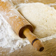Dough with rolling pin — Stock Photo