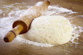 Dough with rolling pin — Stok fotoğraf