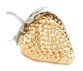 Gold strawberry with silver leaves — Stock Photo