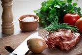 Raw meat on cutting board — Stock Photo