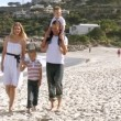 Family walking on the beach — Stockvideo