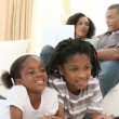 Afro-American children watching television on the floor — 图库视频影像 #22639677