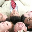 Stock Video: Business team relaxing on floor in a circle