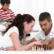 Young Couple Playing Chess in the living room — Stock Video