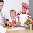 Stock Video: Young Family preparing food in Kitchen