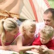 Family camping relaxing on the grass — Stock Video