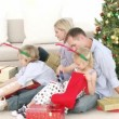 Family playing with Christmas gifts in living-room — Stock Video