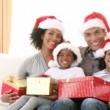 Afro-American family with Christmas gifts on the sofa — Stock Video #22642243