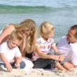 Family playing on the beach — Video