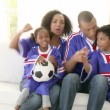 Afro-American family watching a football match at home — Stock Video