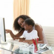 Afro-American mother and daugter using a computer — Stock Video