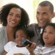 Close-up of Afro-American family watching television — Stock Video #22644543
