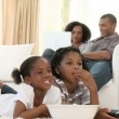 Afro-American children watching a film at home — Video