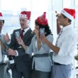 Business team celebrating Christmas in office with champgane — Stock Video