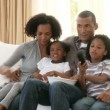 Afro-American family watching television — Stock Video #22645441