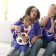 Excited Afro-American family watching a football match — Stock Video