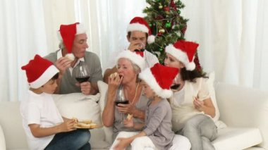 Happy family drinking wine and eating sweets at Christmas — Stock Video