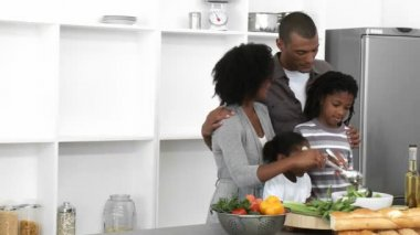 Afro-American family preparing a salad in the kitchen — Stock Video