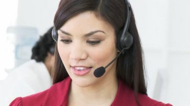 Beautiful woman working in a call center — Stock Video
