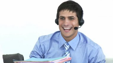 Smiling businessman talking on a headset in a call center — Stock Video